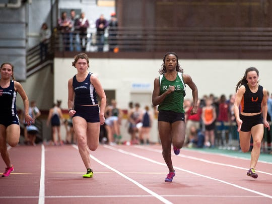 Rice's Sonia John, second from right, nears the finish line en route to winning the Division Ii girls 55 meter dash during the Vermont indoor track state championships last year.