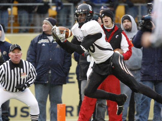 University of Cincinnati's Armon Binns, 80, hauls in the game winning touchdown against the University of Pittsburgh during the fourth quarter of their game played at Heinz Field in Pittsburgh, Pennsylvania Saturday December 5, 2009.