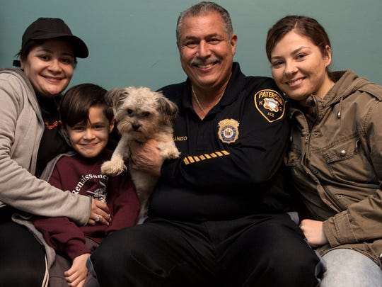 From left, Jazmine Crespo; her son Jacob Rodriguez, 7, with his dog, Brownie; Paterson Animal Control Officer John DeCando; and Adrianne Trastoy, who found Brownie after the dog went missing. They are shown on Wednesday, Jan. 24, 2018.