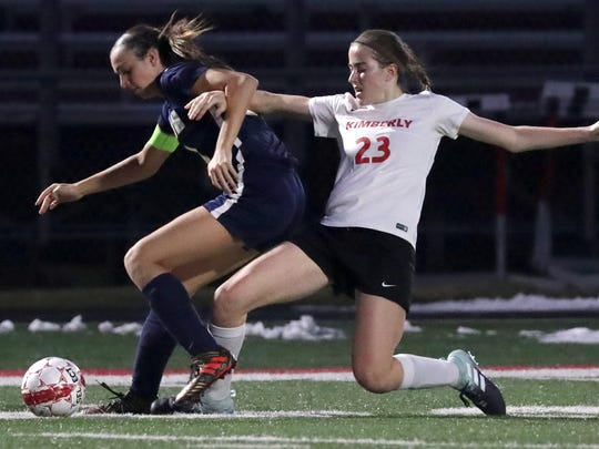 Kimberly High School's Elsi Twombly (23) battles for the ball against Appleton North High School's Kylie Beecher (24) during their girls soccer game on Monday, April 23, 2018 in Kimberly, Wis.