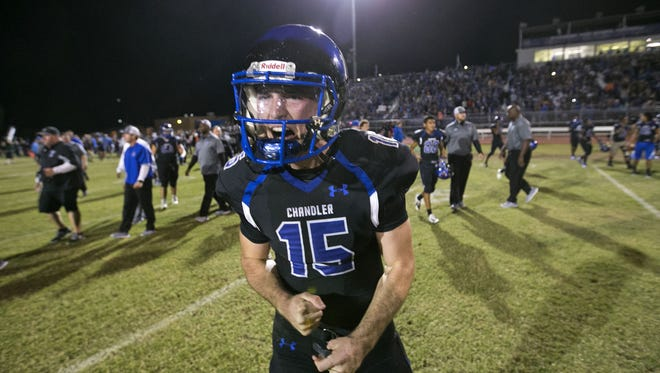 Chandler High quarterback Mason Moran celebrates after Chandler High's 27-20 win over Hamilton High in the high school football game at Chandler High School in Chandler on Friday, October 30, 2015.