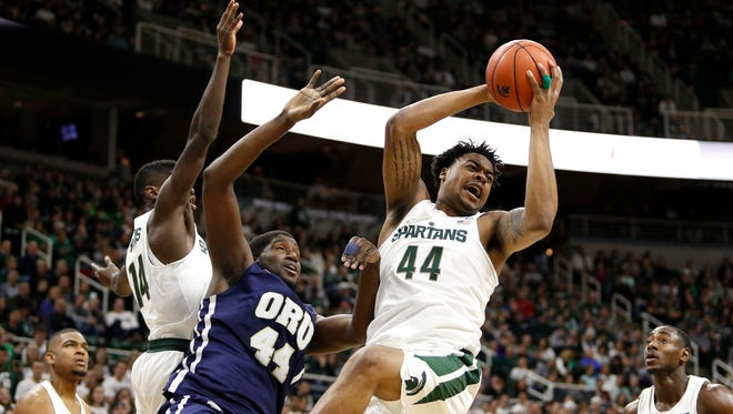 Michigan State forward Nick Ward (44) grabs a rebound against Oral Roberts center Albert Owens (44) during the first half of MSU's 80-76 win Saturday at Breslin Center.
