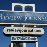 The Las Vegas Review-Journal newspaper sign is shown on Dec. 17, 2015.