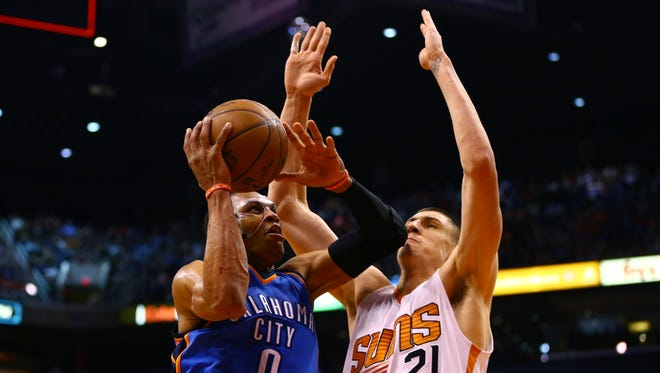 March 29, 2015; Oklahoma City Thunder guard Russell Westbrook drives to the basket against Phoenix Suns center Alex Len in the second quarter at US Airways Center in Phoenix.