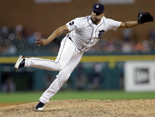 FILE - In this June 16, 2017, file photo, Detroit Tigers relief pitcher Francisco Rodriguez throws during the eighth inning of a baseball game against the Tampa Bay Rays in Detroit. Rodriguez allowed an unearned run and one hit over one inning in his second outing as he bids to win a spot in the Philadelphia Phillies bullpen. Rodriguez, who agreed to a minor league contract in January, walked one and struck out one Monday, Feb. 26, 2018, against the New York Yankees. (AP Photo/Carlos Osorio, File)