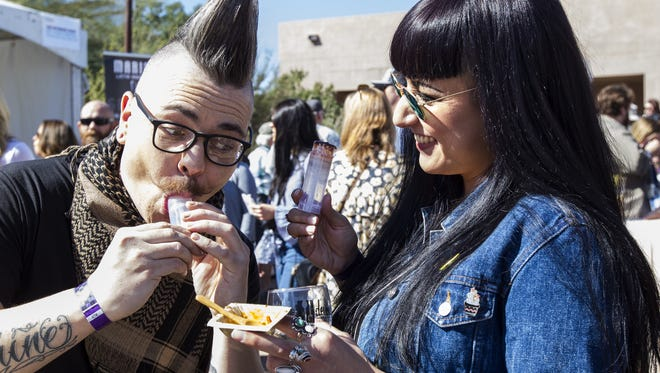 Jesse Perry and Samantha Perry eat push pops during the Devour Culinary Classic on Saturday, Mar. 3, 2018 at the Desert Botanical Garden in Phoenix.
