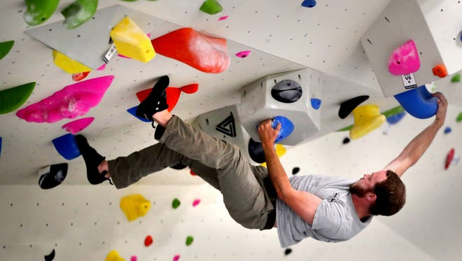 Seth Ramsey boulder climbs at Climb Murfreesboro, one of the newest climbing locations to open in Murfreesboro,  during a soft opening on Wednesday, Aug. 15, 2018.
