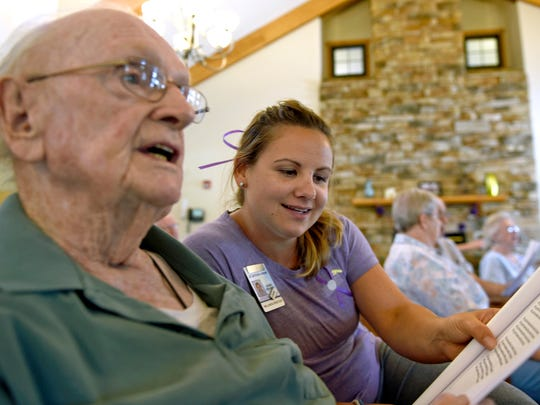 Sadie Brookman, wellness director at The Village at Luther Ridge, sings along with resident Paul Burns on Monday, June 20, 2016, during Longest Day, an event to bring awareness to Alzheimer's disease. Events like singing and riding a Nu Step cardio cycle helped symbolize the challenging journey of those living with the disease and dementia, as well as their caregivers.