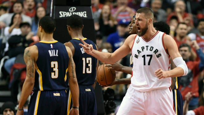 Toronto Raptors' Jonas Valanciunas (17) celebrates after making a dunk against the Indiana Pacers during the second half of Game 5 of an NBA first-round playoff basketball series, Tuesday, April 26, 2016 in Toronto.