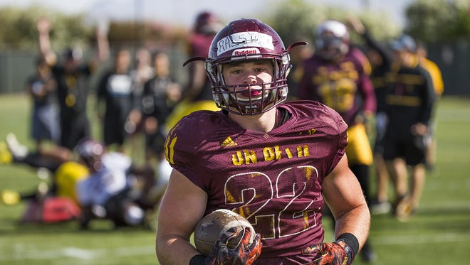 """Arizona State running back Nick Ralston scores a touchdown during the """"W"""" drill at practice at ASU, Wednesday, April 5, 2016."""