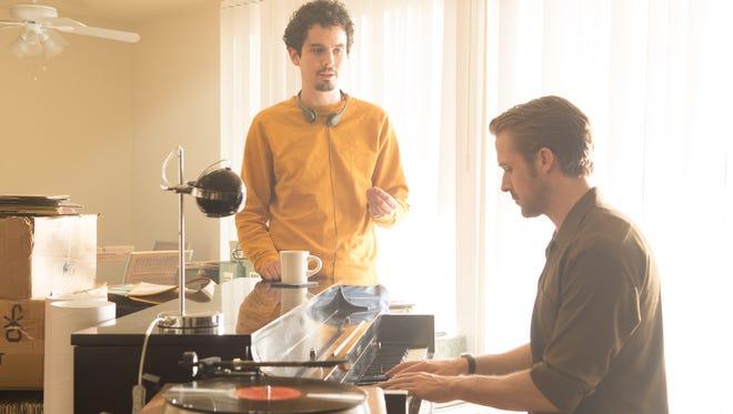 "Director Damien Chazelle (left) and Ryan Gosling on the set of ""La La Land."""
