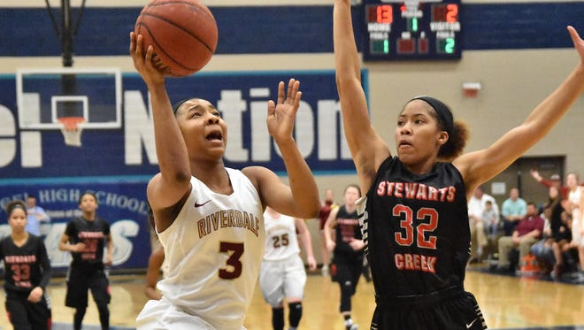 Riverdale's Anastasia Hayes drives to the basket as Brianah Ferby of Stewarts Creek defends during the Region 4-AAA championship.