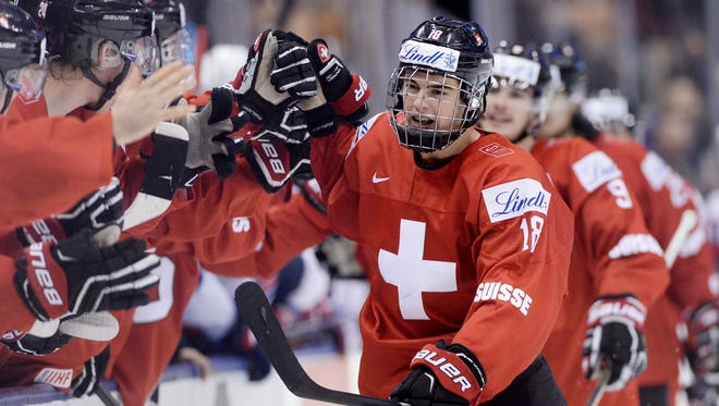Switzerland forward Nico Hischier celebrates with teammates after scoring against the United States during the third period of a world junior championship quarterfinal in Toronto on Jan. 2, 2017.