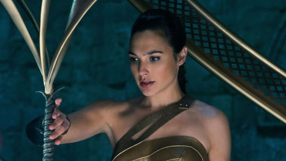 Diana Prince (Gal Gadot) gets her sword before setting