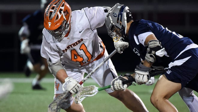 Central York's Kollin Vaught (41) wins a faceoff against Dallastown during the YAIAA semifinals on Wednesday, May 9, 2018. Vaught won his 1,000 career faceoff as he helped the Central York Panthers top the Dallastown Wildcats, 20-8, to advance to the finals.