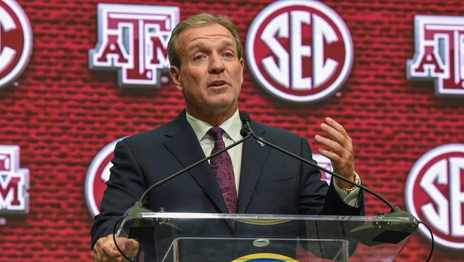 Texas A&M coach Jimbo Fisher addresses the media and answers questions during SEC Media Days on Monday at the College Football Hall of Fame in Atlanta.