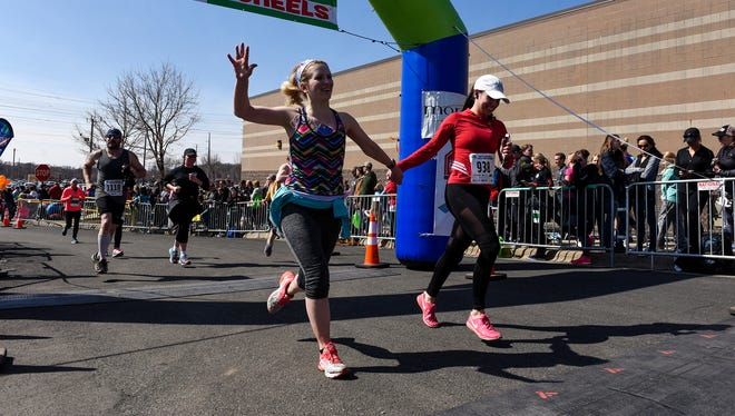 Runners finish the Earth Day Half Marathon Saturday, April 21, in St. Cloud.
