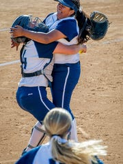 Freshman pitcher Eryka Gonzales, right, and catcher Savanna Salyer-Kovacs start the celebration after the  Scorpions beat Riverside Poly 4-0 to win the Division 2 title. Salyer-Kovacs was named the Coastal Canyon League's Player of the Year.