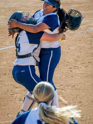 Freshman pitcher Eryka Gonzales, right, and catcher Savanna Salyer-Kovacs start the celebration after the Scorpions beat Riverside Poly 4-0 to win the Division 2 title last year.