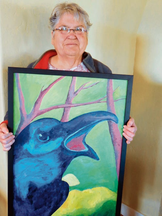 Grant County Art Guild member Dawn Byrum shows her colorful oil painting that was previously entered in the 2015 Southwest Birds Show. Byrum will be the featured artist Sunday at the Hearst Gallery in Pinoa Altos.