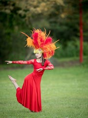 "Dancer Liz Licht portrays the Phoenix in ""Handel's Bestiary."""