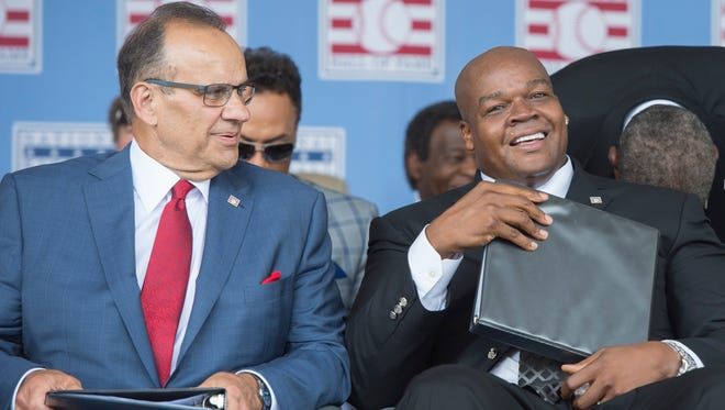 Hall of Fame Inductees Joe Torre (L) and Frank Thomas (R) look on during the class of 2014 national baseball Hall of Fame induction ceremony at National Baseball Hall of Fame.