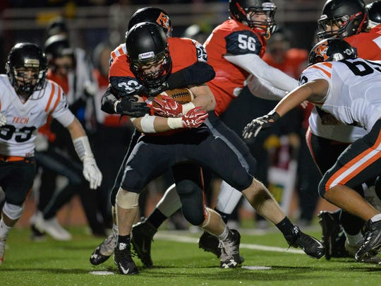 Alexandria's Trappier Botz (32) is tackled by St. Cloud