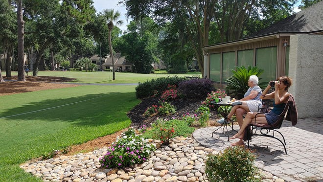 The Bombadiere family enjoys Thursday's opening round of the RBC Heritage outside their condo along the first fairway.