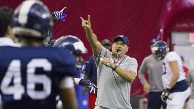 Arizona football coach Rich Rodriguez instructs his team during practice at the Cardinals' training facility in Tempe on August 10, 2016.