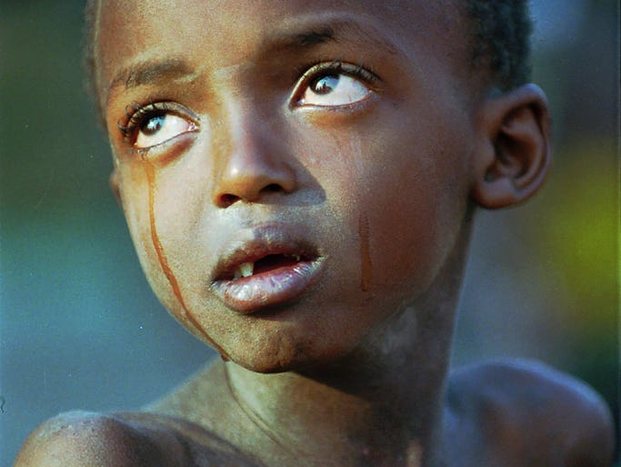 A Tutsi child cries because he can't find his mother at a refugee camp on July 30, 1994, near Goma, Zaire, now named the Democratic Republic of Congo. Some 800,000 minority Tutsi and moderate Hutu people were slaughtered by Hutu extremists during a 100-day terror campaign that began on April 7, 1994.