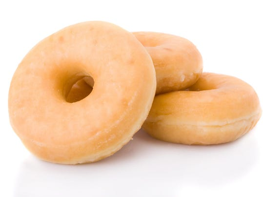 Three doughnuts or donuts piled