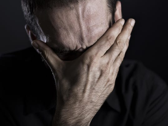 Close up of depressed and despaired man.