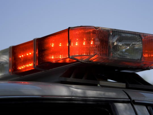 Red lights on top of a police patrol car