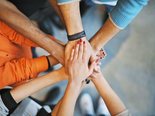 Stack of hands a teamwork symbol