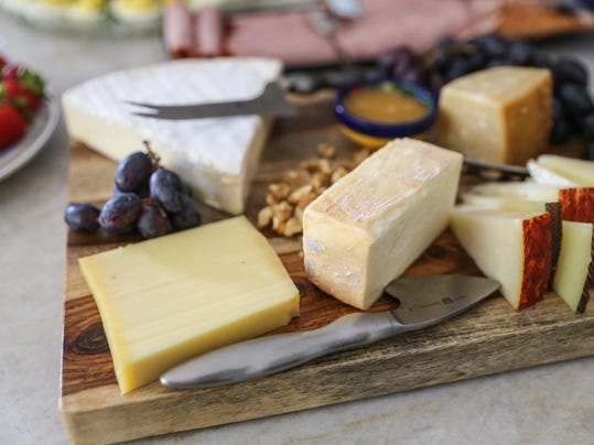 Cheese spread on a wooden serving board