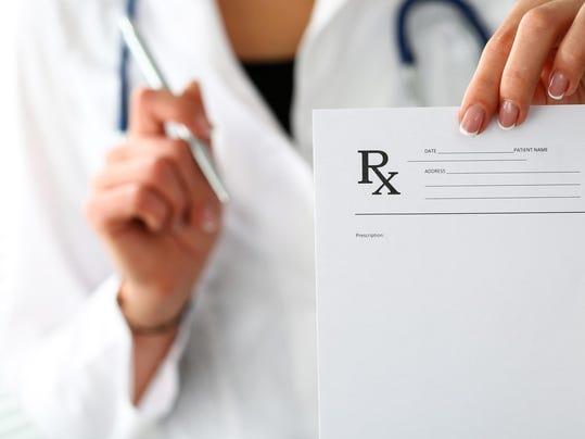 Female medicine doctor hand give prescription to patient