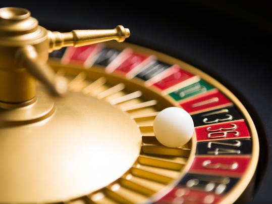 casino roulette wheel with the ball on number 36