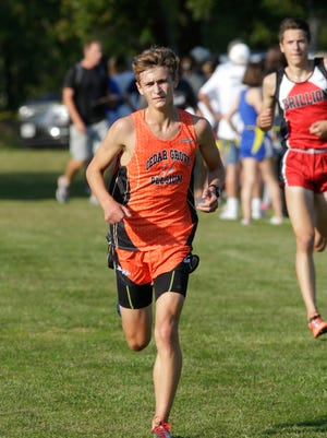 Cedar Grove-Belgium's Peter Lavey arrives in second place at the Sheboygan Lutheran Cross Country Invitational Tuesday, September 12, 2017, in Sheboygan, Wis.