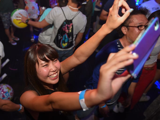 Club goers hit the dance floor during the Electronic