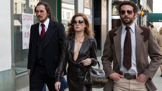 """Christian Bale, left, Amy Adams and Bradley Cooper all received Oscar nominations for their work in """"American Hustle."""" The film is among the top nominees for the Academy Awards."""