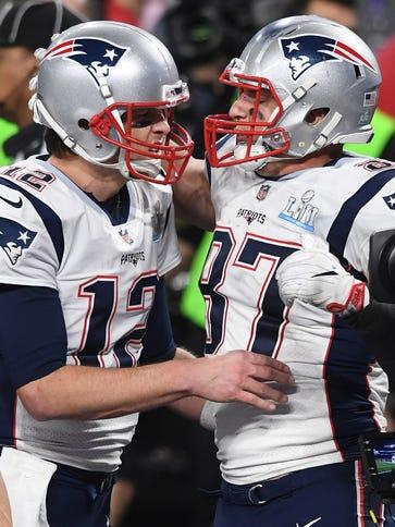Patriots QB Tom Brady (12) and TE Rob Gronkowski have
