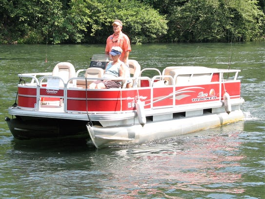Guide Kevin Attendorn uses an 18-foot party barge to