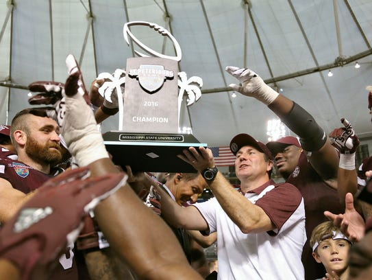 Dan Mullen celebrates winning the St. Petersburg Bowl last year with his team.