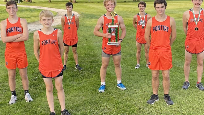 Pontiac's cross country Indians claimed the team title of the Trojan Invitational Tuesday. Aidan Lee, third from left, won the race to pace PTHS. Also competing were Sam Fogarty, Ethan Schickel, Weiland Torkelson, Aiden Christenson, Jaxen Paine and Dustin Brockett.