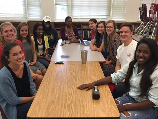 Local Student Government Association representatives discuss a plan to make student government coursework honors credit for all students in Florida.