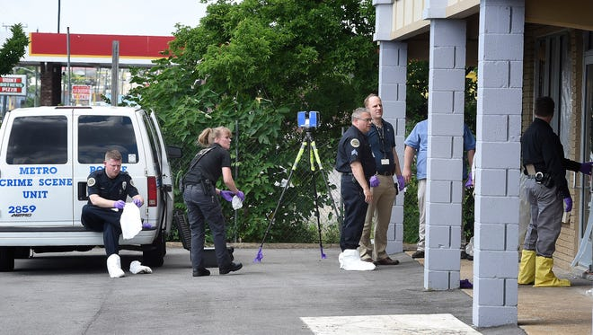 Metro police are investigating 2 decomposing bodies found in a recently renovated store in the 700 block of Dickerson Pike on Friday June 17, 2016.