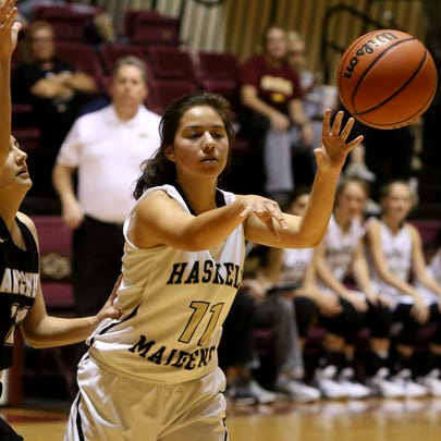 Haskell's Ariel Martinez passes in the small girls