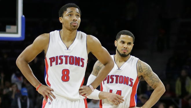 Detroit Pistons guards Spencer Dinwiddie, left, and D.J. Augustin walk off the court as time expires against the Los Angeles Clippers on Nov. 26, 2014.