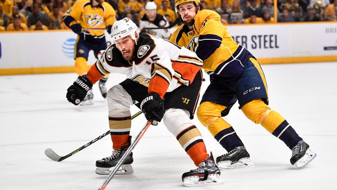 Ducks center Ryan Getzlaf (15) battles Predators left wing Filip Forsberg (9) during the second period of Game 3 of the Western Conference finals at the Bridgestone Arena on Tuesday, May 16, 2017.