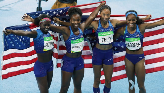 Aug 19, 2016; Rio de Janeiro, Brazil; Tori Bowie and Tianna Bartoletta and Allyson Felix and English Gardner (USA) celebrate after winning the women's 4x100m relay final in the Rio 2016 Summer Olympic Games at Estadio Olimpico Joao Havelange. Mandatory Credit: Matt Kryger-USA TODAY Sports